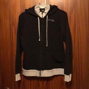 Oakley women's black hooded sweatshirt. Size med.